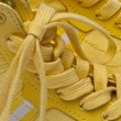 Stock Photo: Laces of Yellow Shoes