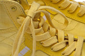 Laces of Yellow Shoes — Stock Photo