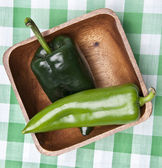 Green Peppers in a Bowl on a Picnic Blan — Stock Photo