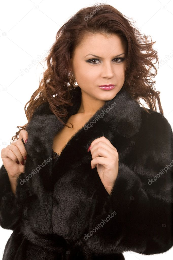 Young woman in fur coat on white background  Stock Photo #1377350