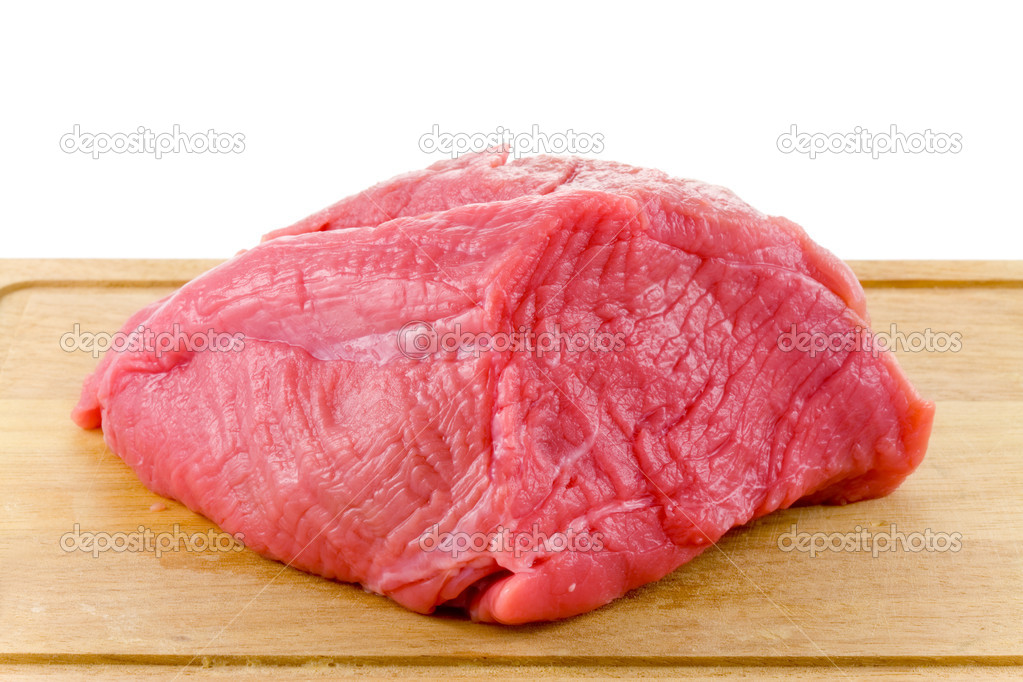 Raw beef on wood board isolated on white background — Stock Photo #1378522