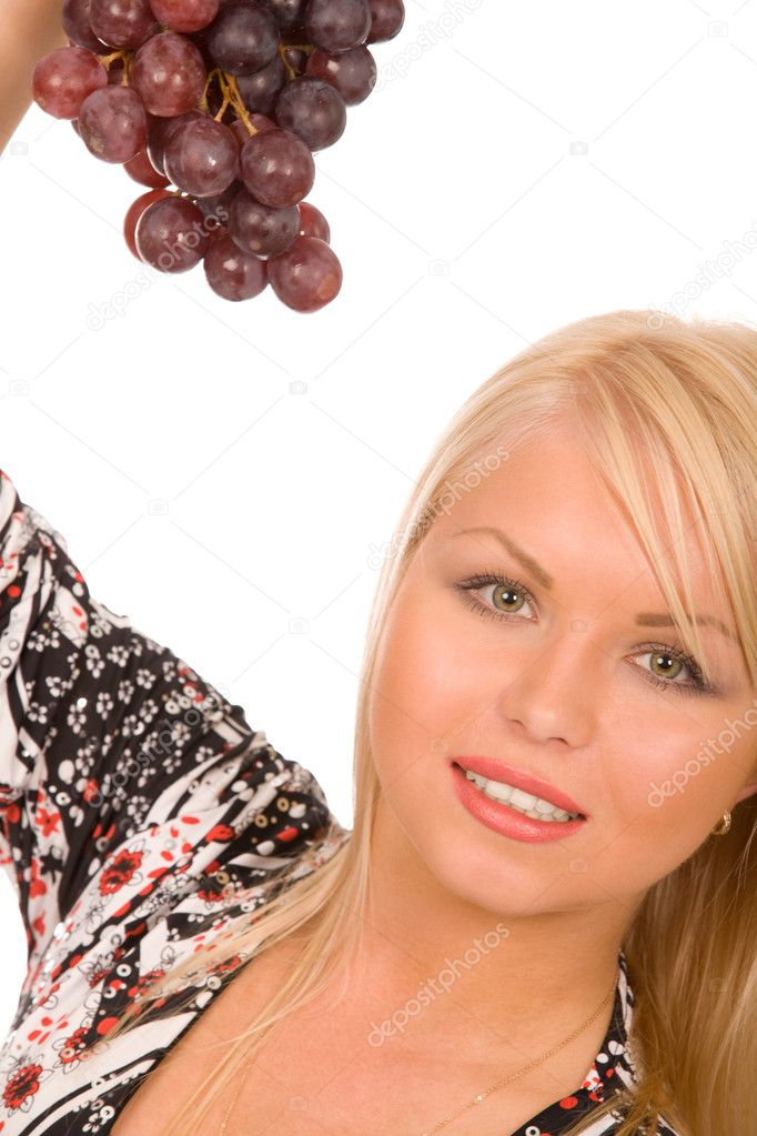 Young blond woman with grapes isolated on white  Stock Photo #1379992