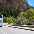 The modern tourist bus on mountain road — Stock fotografie