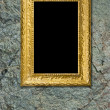 Royalty-Free Stock Photo: Stone background with gold frame