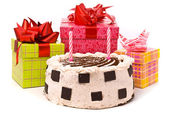 Pie with two candles and gifts — Stock Photo