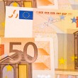 Stock Photo: Fifty Euro banknotes background