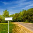 Clear sign in beautiful forest road — Stock Photo