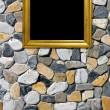 Royalty-Free Stock Photo: Golden frame on a stone background