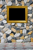 Golden frame on a stone background — Stock Photo