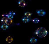 Soap bubbles on black background — Stock Photo