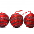 Three red balls studio isolated on white — Stock Photo