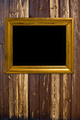 Grunge wood background with gold frame — Stock Photo