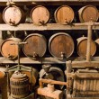 Wine barrels stacked in the old cellar — Stock Photo