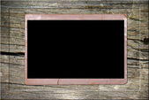 Vintage photo card in wooden frame — Stock Photo