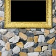 Royalty-Free Stock Photo: Golden frame on beautiful stones