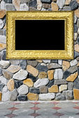 Golden frame on beautiful stones — Stock Photo
