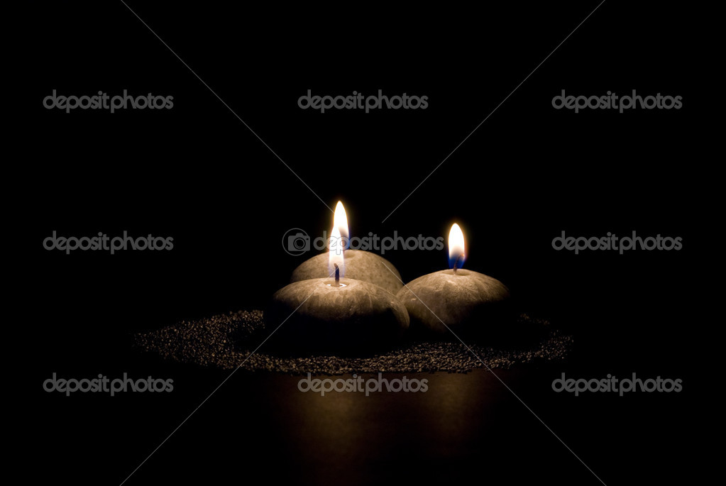 Three candles in the form of stones on a black background — Stock Photo #1636237