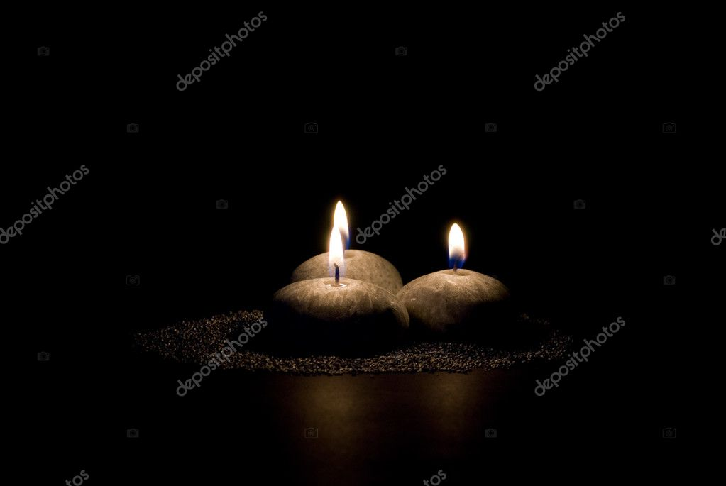 Three candles in the form of stones on a black background  Stock Photo #1636237