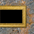 Stone background with vintage gold frame — Stock Photo