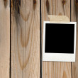 Wood background with photo card — Stock Photo