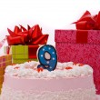 Pink pie with candle and gifts in boxes — 图库照片