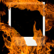 Royalty-Free Stock Photo: Vintage photo card in burning fire