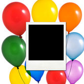 Multicolored balloons and photo frame — Stock Photo