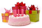 Pink pie with nine candles and gifts — 图库照片