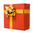 Red gift box with golden bow — Stock Photo #1759752