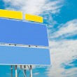 Road sign on sky background — Stock Photo
