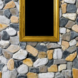 Golden frame on stone background - Stock Photo