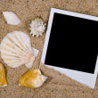Photo frame with sea shells on sand — Stock Photo