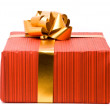 Stock Photo: Red gift box with golden bow