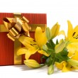 Royalty-Free Stock Photo: Yellow lily and gift box