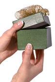 Gift in woman hand, studio shot — Stock Photo