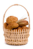 Fresh buns and ears of wheat — Stock Photo