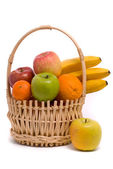 Basket with colorful fruits — Stock Photo