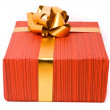 Red gift box with golden bow — Stock Photo