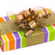Stock Photo: Gift box with golden bow on white
