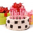 Pie with twelve candles and gifts - Stock Photo