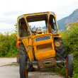 The old broken tractor — Stock Photo