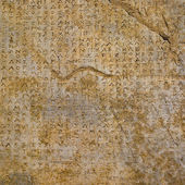 Stone background Greek inscriptions — Stock Photo