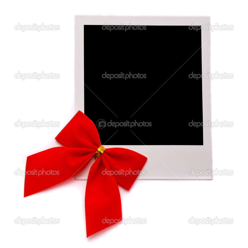 Old photo card with red bow isolated on a white background — Stock Photo #2135704