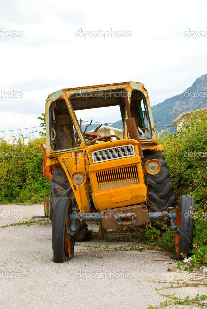 The old broken tractor  Stock Photo #2138033