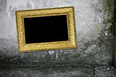 Grunge interior with vintage gold frame — Foto de Stock