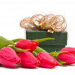 Red tulips and gift box on a white — Stock Photo