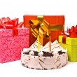 Stock Photo: Pie with two candles and gifts in boxes