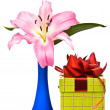 Pink lily and gift box — Stock Photo