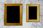 Grunge interior with vintage gold frame — Stockfoto