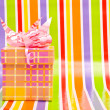 Gift box on a stripe background — Stock Photo